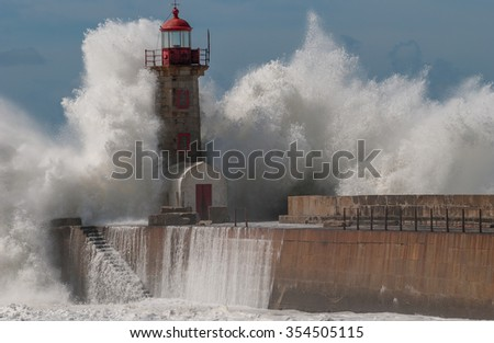 Storm near the lighthouse at the Porto. Portugal. - stock photo