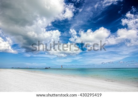 Storm on the Bavaro beach at Dominican Republic - wide angle landscape photo of still ocean and lonely beach before tropical storm. - stock photo