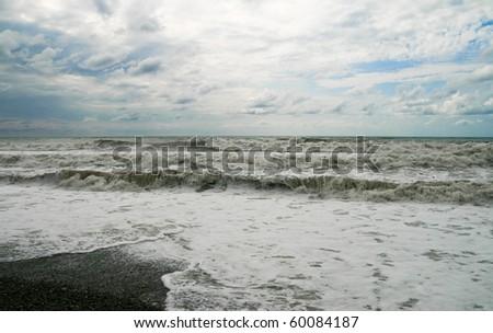 Storm on the sea. Waves run on coast - stock photo
