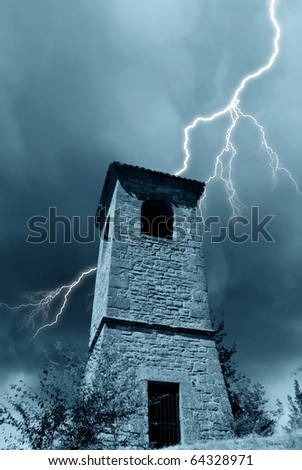 storm over an old bell - stock photo