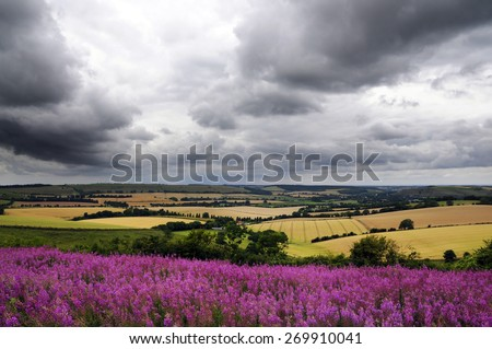 storm over landscape - stock photo