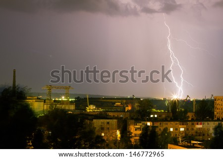 Storm over the city. Lightning flashed