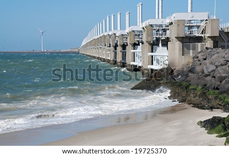 storm surge barrier protects the low land below sea level against flooding - stock photo