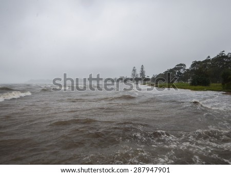 Storm surge tide at Sandgate in Brisbane after Cyclone Marcia. - stock photo