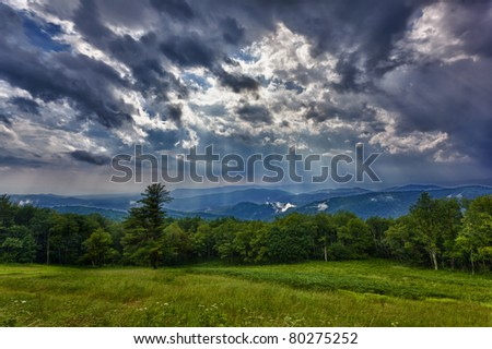 Storm sweeps over Shenandoah Valley from Skyline Drive in the Blue Ridge Mountains of Virginia - stock photo