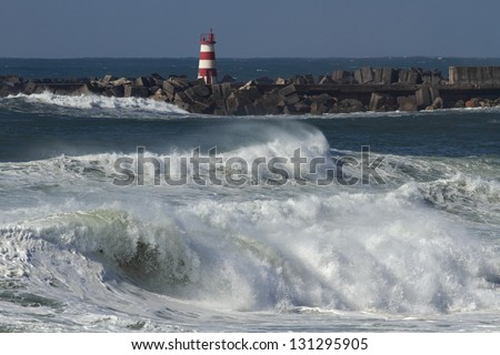 Storm waves in the beacon of the harbor of Povoa do Varzim, Portugal - stock photo