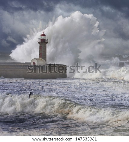Storm waves over the Lighthouse, Portugal - enhanced blue sky  - stock photo