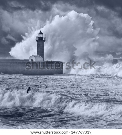 Storm waves over the Lighthouse, Portugal - enhanced blue sky - dark blue filter - stock photo