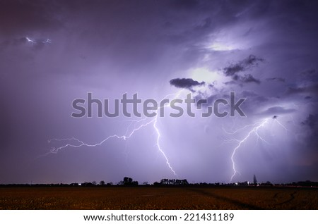 Storm with lightning in landscape - stock photo