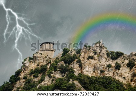storm with rain lightning and rainbow - stock photo