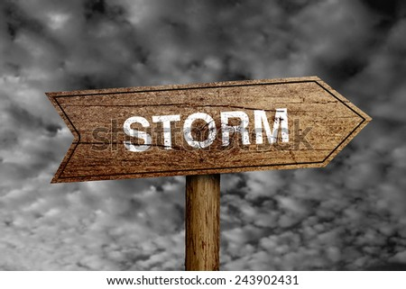 Storm wooden road sign with dark cloudy sky background. - stock photo