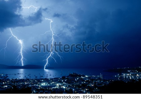 Storms with lightning above the resort in Bodrum Turkey - stock photo