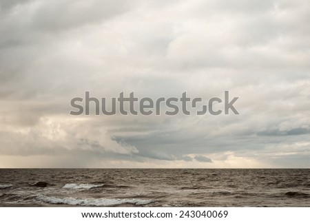 stormy baltic sea and the cloudy sky in winter background - stock photo
