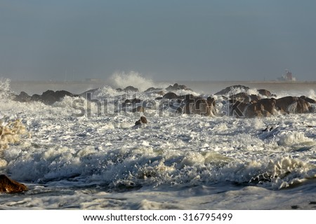 Stormy breaking waves in a sunny day. Beach from the north of Portugal. - stock photo