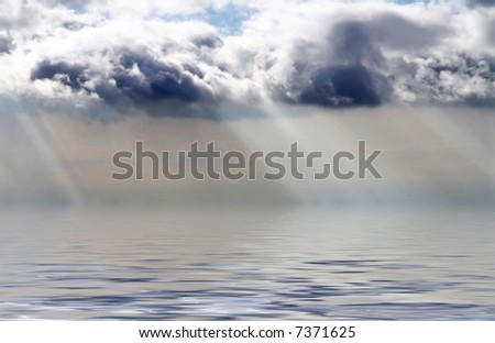 Stormy clouds and light streaks reflecting on the ocean