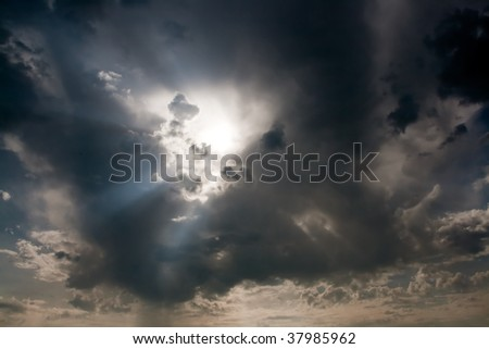 Stormy clouds at sunset - stock photo