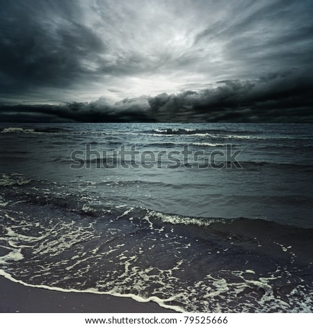 Stormy clouds over dark ocean