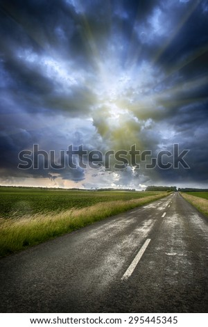 Stormy clouds over road