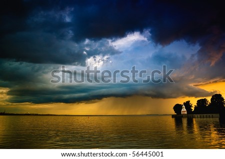 Stormy clouds over sea with - stock photo