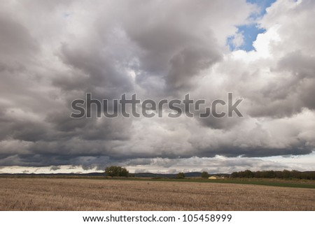 Stormy clouds over the field