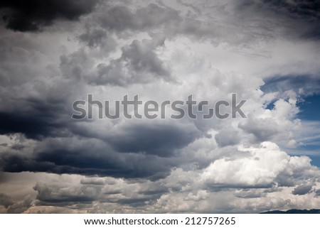 Stormy clouds with a little bit of blue sky - stock photo