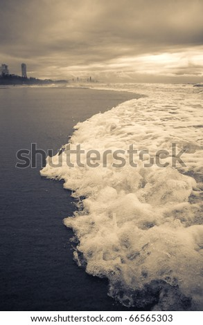 Stormy Gold Coast Beachfront With Dramatic Waves Rushing To Shore, Taken Burleigh Beach, Queensland, Australia - stock photo