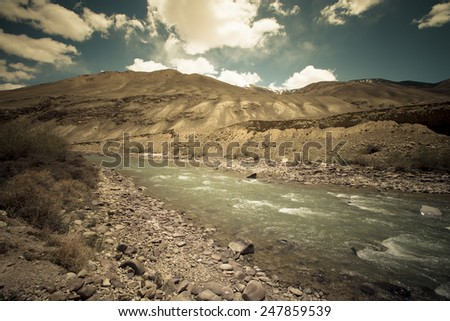 Stormy mountain river in valley in the foothills of the Fann mountains. Landscape. - stock photo