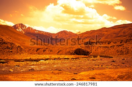 Stormy mountain river in valley in the foothills of the Fann mountains. Landscape. Toned.