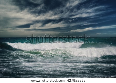 Stormy ocean landscape with rainy clouds - stock photo