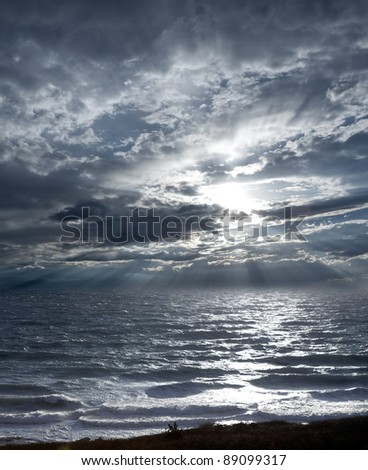 Stormy sea and sky an hour before sunset - stock photo