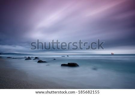 Stormy sea before sunrise - stock photo