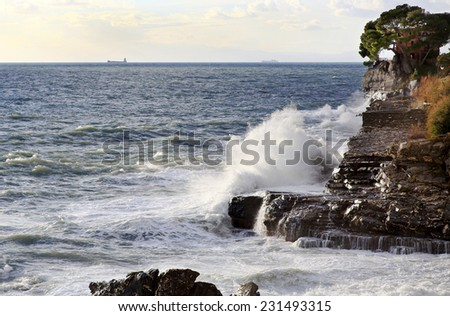 stormy sea over ligurian coast near Recco village - stock photo