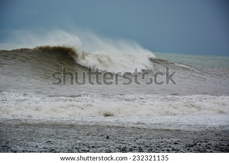 Stormy sea waves breaking near the coast - stock photo