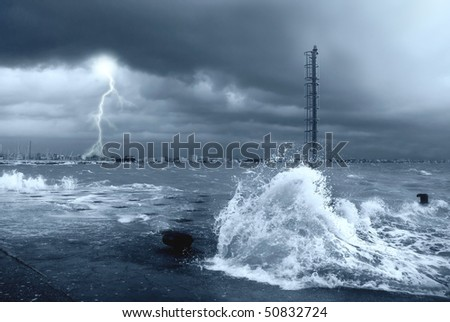 stormy sea with lightning and big waves - stock photo