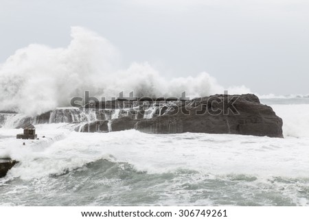 Stormy sea with waves crashing on rocks during Typhoon Souledor - stock photo