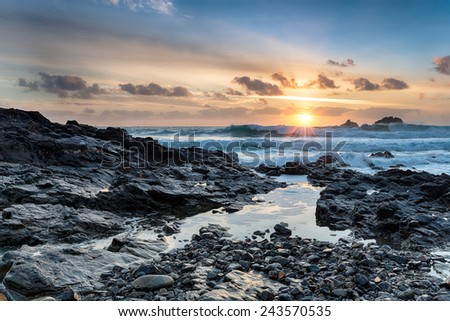Stormy seas at Priest's cove on Cape Cornwall on the wild and rugged Cornish coastline - stock photo