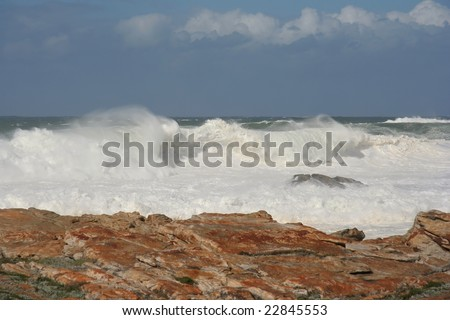 Stormy seas with huge wild waves off the coast - stock photo