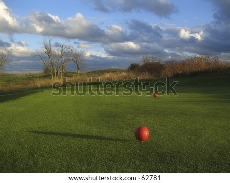 Stormy skies and dramatic light at a golf course. - stock photo