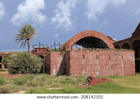 Stormy skies preside over one of Fort Jefferson's powder magazines. - stock photo