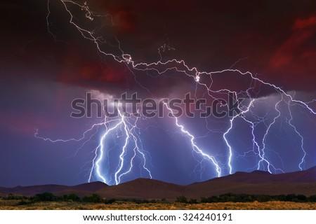 Stormy Skies with multiple lightning strikes - stock photo
