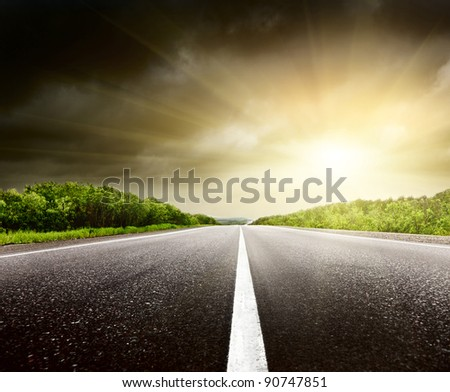 stormy sky and road in forest