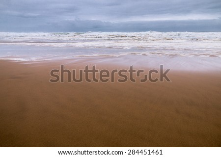 Stormy sky and sea at low-tide  - stock photo