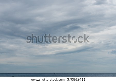 Stormy sky and ships on horizon - stock photo