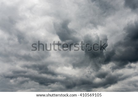Stormy sky covered with dark dramatic clouds - stock photo