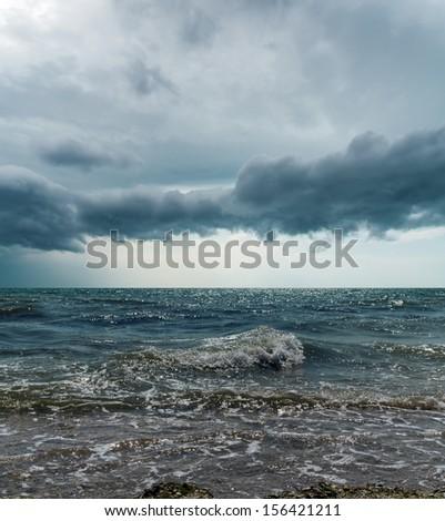 stormy sky over dark sea - stock photo