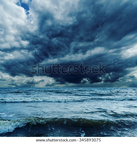 stormy sky over dark sea with waves