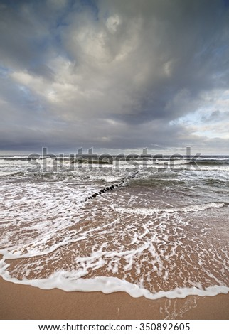 Stormy sky over rough Baltic Sea. - stock photo