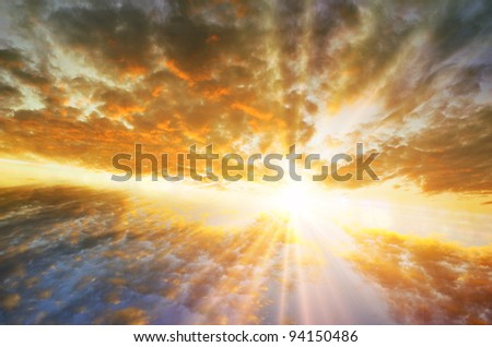 Stormy sky with sun protruding through clouds - stock photo