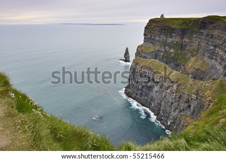 Stormy Sunset and Cliffs of Moher on west coast of Republic of Ireland
