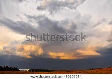 Stormy sunset in the plains - stock photo